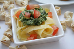 Pasta and pesto stock images
