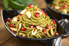 Pasta with Pesto, Almonds and Pomegranate Stock Photos