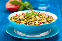 Pasta with Pesto, Almonds and Pomegranate Royalty Free Stock Images