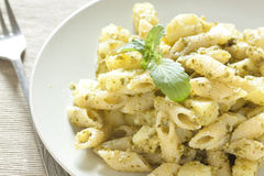 Pasta with pesto Stock Photography