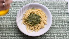 Pasta with pesto stock video footage