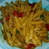 I love the little tomato in Pasta with pesto. It& x27;s fantastic. royalty free stock photos