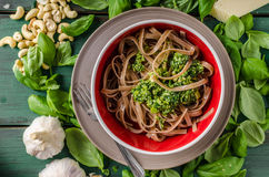 Pasta with pesto. Ingredience around meal, simple and delicious italian meal Stock Image
