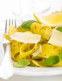 Pasta with pesto, lemon, basil and parmesan cheese Royalty Free Stock Photos