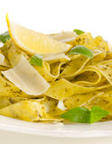 Pasta with pesto, lemon, basil and parmesan cheese Royalty Free Stock Images