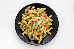 Pasta with pesto, parmesan and crab tails Stock Photos