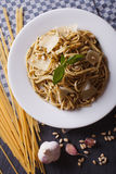 Pasta with pesto and parmesan and ingredients closeup. vertical Royalty Free Stock Images