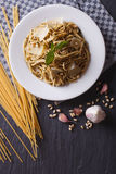 Pasta with pesto and parmesan and ingredients. vertical top view Stock Image