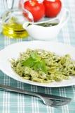 Pasta with pesto sauce stock photos
