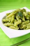 Pasta with pesto sauce. Pasta with Italian pesto sauce with basil stock photos