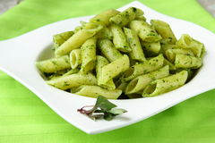 Pasta with pesto sauce. Pasta with Italian pesto sauce with basil royalty free stock photography