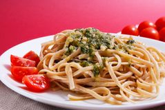 Pasta with pesto sauce Stock Images