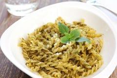 Pasta with pesto sauce Royalty Free Stock Photography