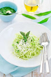Pasta with pesto sauce. On a dish Stock Images