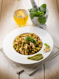 Pasta with pesto sauce and chicken Stock Images