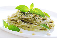 Pasta with pesto sauce, fresh basil and pine nuts Royalty Free Stock Photography