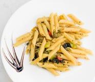 Pasta with pesto sauce Royalty Free Stock Photos
