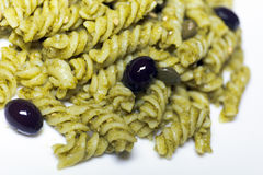 Pasta with pesto sauce and olives and capers Stock Photo