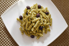 Pasta with pesto sauce and olives and capers Stock Image