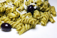 Pasta with pesto sauce and olives and capers Royalty Free Stock Image