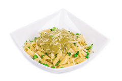 Pasta with pesto sauce and parmesan. Stock Photo