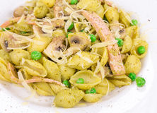 Pasta with pesto sauce peas and nuts Stock Photo