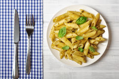 Pasta with pesto sauce Stock Photos