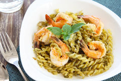 Pasta with pesto sauce and prawn Royalty Free Stock Image