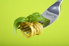 Pasta with pesto sause and parmesan on fork Stock Image
