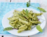 Pasta with pesto sause Stock Photos