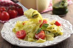 Pasta with pesto and tomato Stock Photography