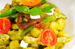 Pasta pesto and vegetables Royalty Free Stock Photo