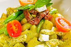 Pasta pesto and vegetables Stock Photos