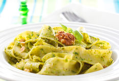 Pasta with pesto and walnuts Royalty Free Stock Photography