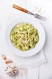 Pasta with pesto on white plate Stock Image