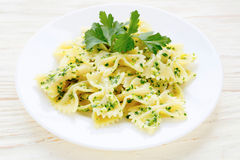 Pasta with pesto on white plate Stock Photos