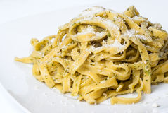 Pasta with pesto on white plate Stock Image