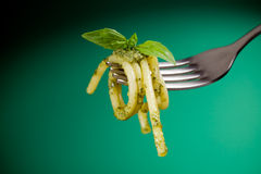 Pasta with pesto wrapped on a fork Stock Photo