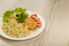 Pasta with a piece of grilled meat and salad. royalty free stock image