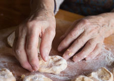 Pasta, pizza,. Female hands prepare  good pasta Stock Images