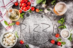 Pasta pizza italian food ingredients. Homemade pasta pizza italian food ingredient on dark rusty table with flour, olive oil, basil, tomatoes and kitchen Stock Images