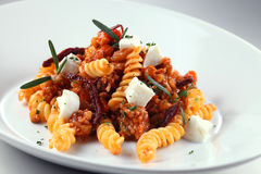 Pasta. A plate of pasta with dry tomato and cheese Royalty Free Stock Image