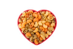 Pasta on the plate in the form of heart Royalty Free Stock Images