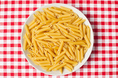 Pasta in plate on picnic tablecloth Royalty Free Stock Photography