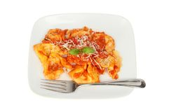 Pasta on a plate. Tortelloni pasta on a plate with a fork isolated against white, top view Royalty Free Stock Photography