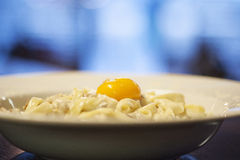 Pasta on the plate with yolk Royalty Free Stock Photography