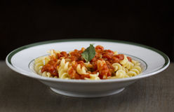 Pasta. Plated dish with pasta, red sauce, and basil Stock Image
