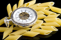 Pasta and Pocket Watch Stock Images