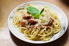 Pasta Pomodoro. Close-up pasta with red tomato sause pomodoro, parmesan and basil Royalty Free Stock Photography