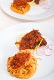 Pasta with pork ribbs sauce on polenta bed Stock Photos
